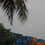 moonrise over container yard yangon