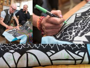 Stanley Donwood signs the tapestry
